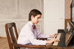 Boy Playing Piano Stock Image