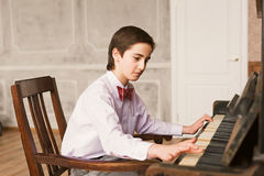 Boy Playing Piano Stock Photos