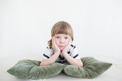 Boy playing with pillows stock image