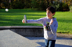 Boy playing ping pong Stock Photos