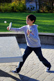 Boy playing ping pong Stock Photo