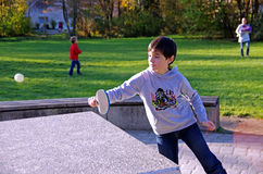Boy playing ping pong in the park Royalty Free Stock Photo
