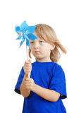 Boy playing with pinwheel Royalty Free Stock Photography