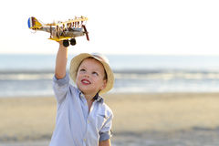 Boy playing with plane Royalty Free Stock Photo