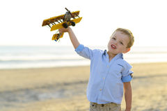 Boy playing with plane Royalty Free Stock Image