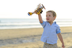 Boy playing with plane Royalty Free Stock Photos