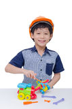 Boy playing with plane and train toy Royalty Free Stock Photo