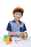 Boy playing with plane and train toy Stock Image