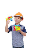 Boy playing with plane and train toy Stock Photo
