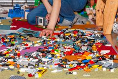 Boy playing with plastic construction toys on the floor. royalty free stock image