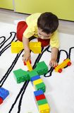Boy playing with plastic cubes Stock Photography