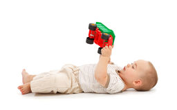Boy playing with plastic toy car Stock Photo