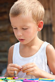 Boy playing with plasticine. Stock Image
