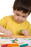 Boy playing with plasticine Stock Images