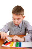 Boy playing with Plasticine Royalty Free Stock Photography
