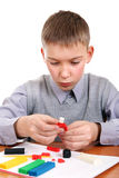 Boy playing with Plasticine Royalty Free Stock Photos