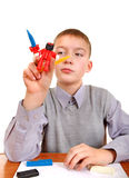 Boy playing with Plasticine Stock Photo