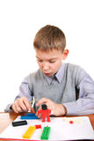 Boy Playing with Plasticine Stock Photos