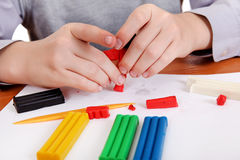 Boy Playing with Plasticine Royalty Free Stock Images
