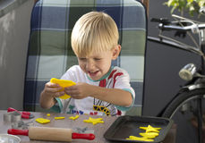 Boy playing with plasticine Stock Photography