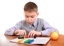 Boy playing with Play Dough Royalty Free Stock Photo