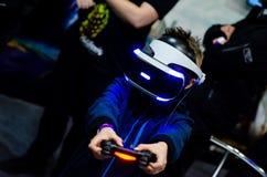 Kyiv, Ukraine - April 12, 2019: Boy playing PlayStation VR stock photography