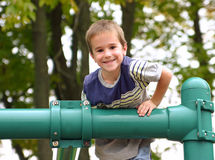 Boy playing at the playground Stock Image