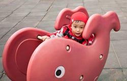 Boy playing on playground Royalty Free Stock Image