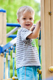Boy playing at playground Royalty Free Stock Image