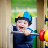 Boy Playing on Playground Stock Image