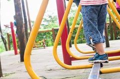 Boy playing on playground Royalty Free Stock Photos