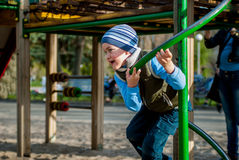 Boy playing on the playground Stock Images