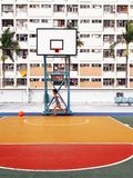 Boy playing in Playground in Rainbow estate in Hong Kong. Boy playing basketball and chasing in Playground in Rainbow colored wall estate public housing in Choi Royalty Free Stock Photos