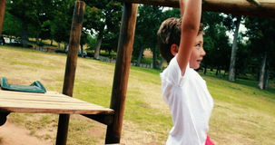 Boy playing on a playground ride in park stock footage