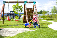 Boy playing at a playground with sand Royalty Free Stock Photos