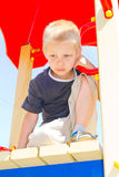 Boy playing on the playground Royalty Free Stock Photography