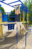 Boy playing on the playground Stock Photos