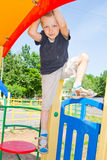 Boy playing on the playground Stock Photography