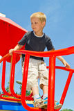 Boy playing on the playground Royalty Free Stock Image