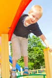 Boy playing on the playground Royalty Free Stock Images