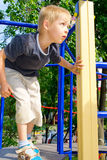 Boy playing on the playground Royalty Free Stock Photos