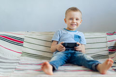 Boy playing with playstation Royalty Free Stock Photo