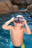 Boy playing in pool royalty free stock image
