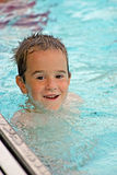 Boy Playing in the Pool Stock Images