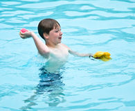 Boy Playing in the Pool royalty free stock images