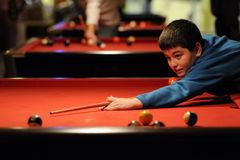 Boy playing pool ball Royalty Free Stock Images
