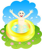 Boy playing in a pool Stock Photo
