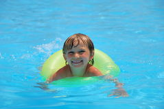 Boy playing in pool inner tube Stock Photo