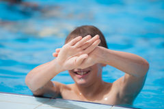 Boy playing in the pool Royalty Free Stock Photo