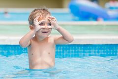 Boy playing in a pool of water Stock Image